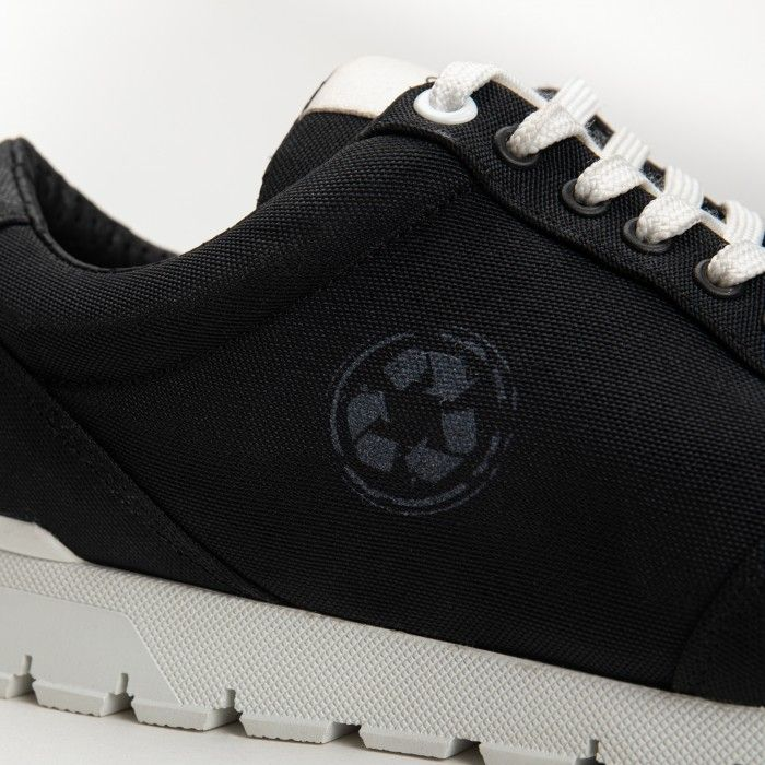 nilo black trainers sneakers made with plastic collected from the ocean